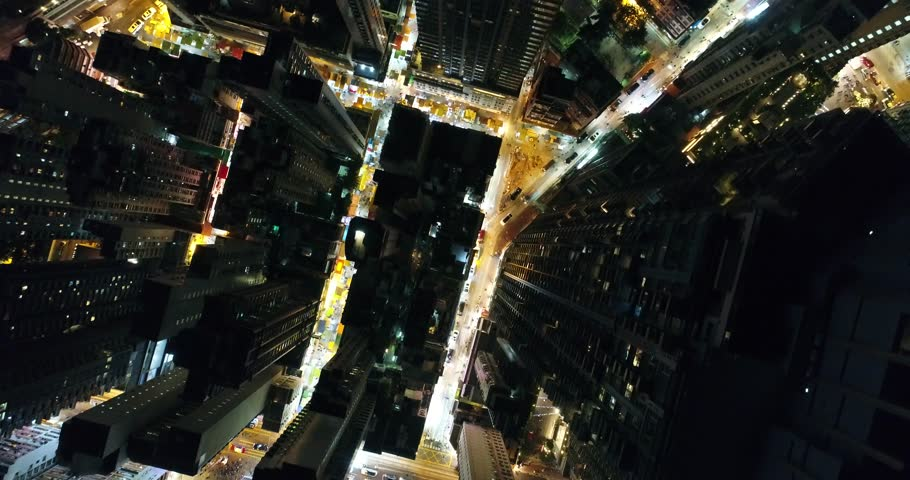 AERIAL. Brid eyes view from drone of Hong Kong city at night time