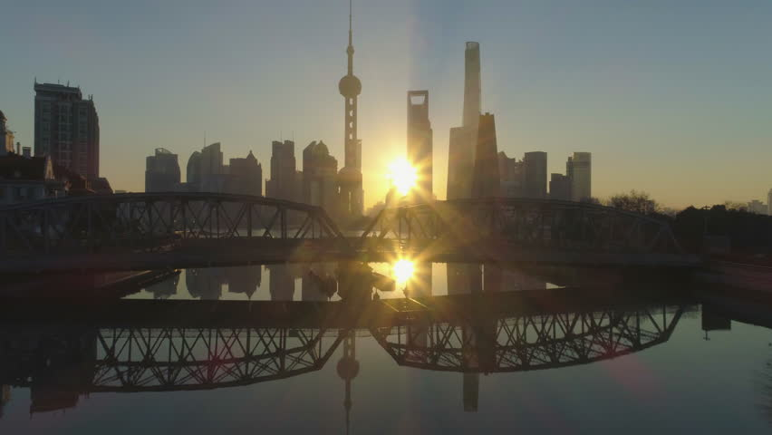 Shanghai Skyline at Sunrise at the Sunny Morning. China. Aerial View. Drone is Flying Over Waibaidu Bridge. Establishing Shot.