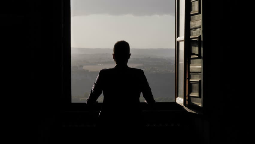 Morocco, Silhouette of man looking through open window, woman walking and embracing him from behind | Shutterstock HD Video #1007298136