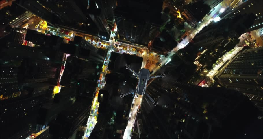 AERIAL. Animation of Drone (Multi-rotor) flying above the city panorama at night scene. | Shutterstock HD Video #1007325742