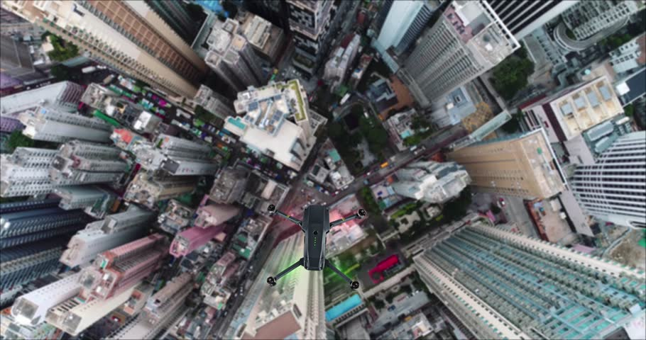 AERIAL. Animation of drone quad copter with high resolution digital camera flying over the Hong Kong city #1007325757