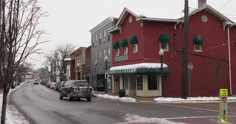 A day winter exterior establishing shot of a generic small town's Main Street shopping district storefronts and traffic.  Summer matching available. | Shutterstock HD Video #1007346034