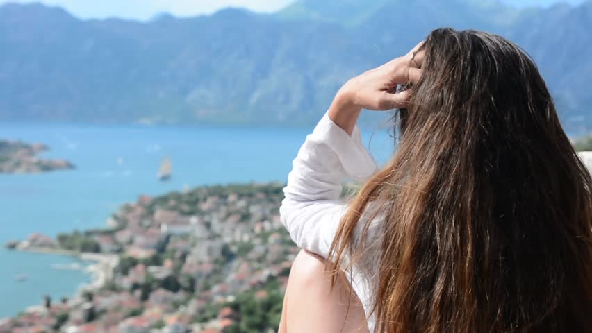 A girl looks from the heights to the Boka Bay of Kotor   Shutterstock HD Video #1007346640