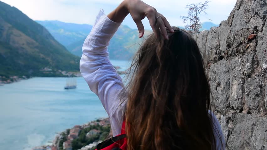 A girl looks from the heights to the Boka Bay of Kotor | Shutterstock HD Video #1007346646