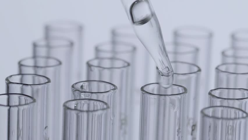 Laboratory scientist working with a pipette analyzes and extract the DNA or molecules in the test tubes.on white background | Shutterstock HD Video #1007352541