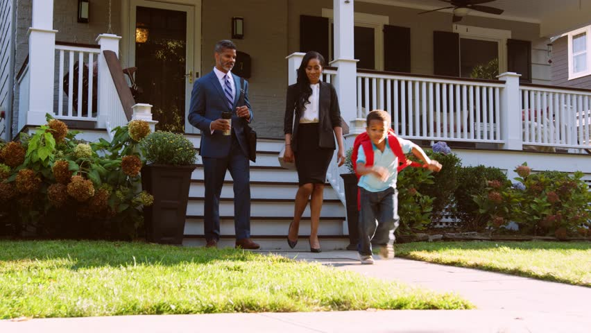 Business Couple With Son Leaving House For Work And School