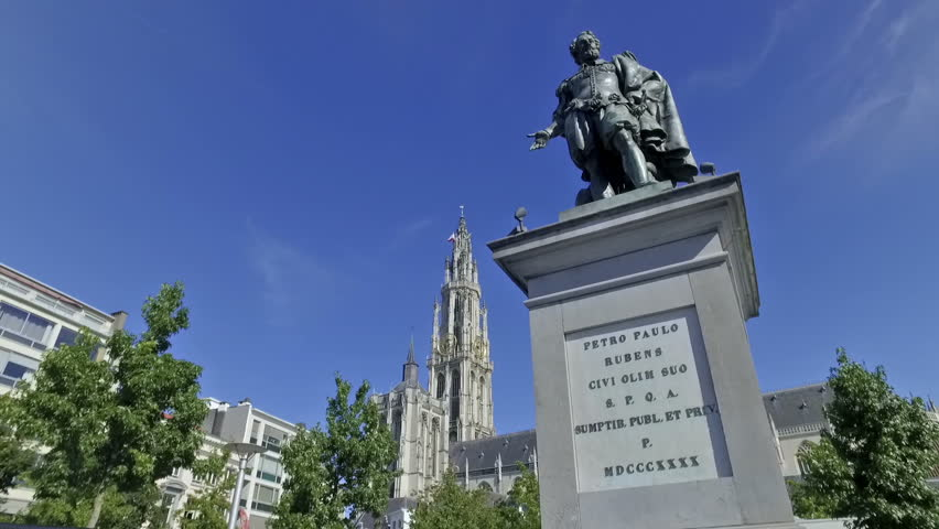 Rubens statue in Antwerp, Belgium in a sunny day. Cathedral of Our Lady in the background.