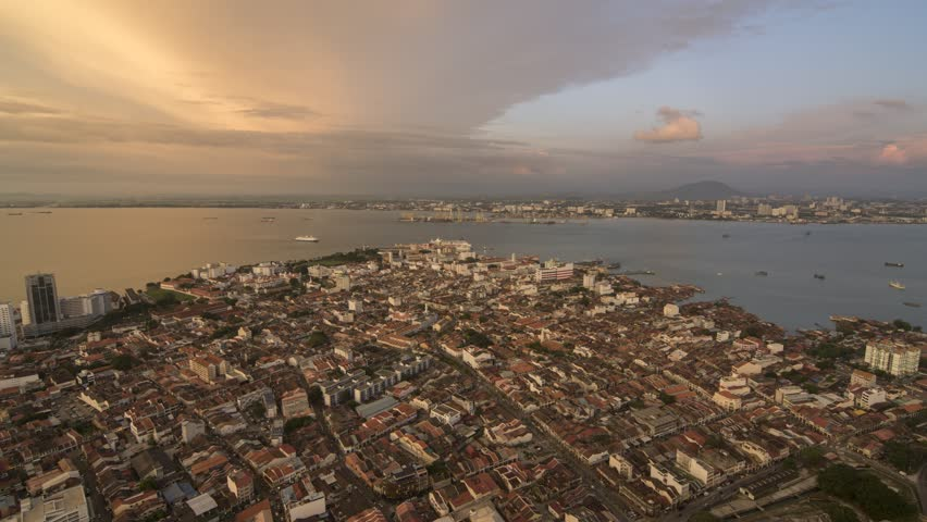 Timelapse aerial view UNESCO world heritage site Georgetown city from day to night. Busy traffic for road and sea of Malacca Straits.