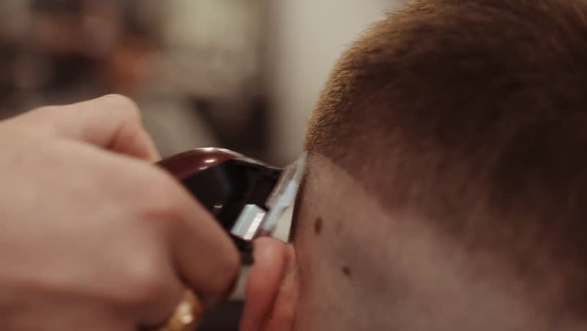 Barber makes a man's haircut. Body care. Video retro toning. Dynamic frame shaking. #1007431411