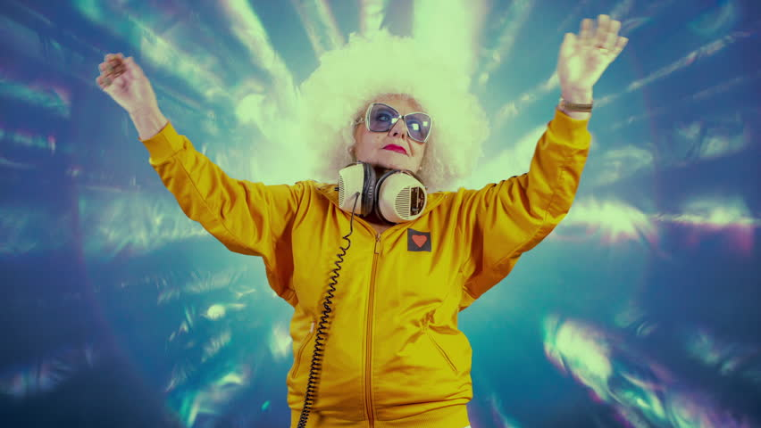 Time lapse of DJ grandma with white afro hair, sunglasses and headphones raving in club #1007433355