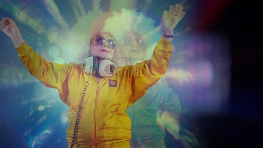 An amazing grandma disco dancer and dj, older lady partying in a hypnotic colourful disco setting.   Shutterstock HD Video #1007433400