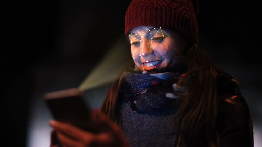 Smartphone using facial recognition system to unlock. A woman face is being scanned as a security measure. Face detection points. Perfect to illustrate: security system, futuristic technology.