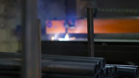 Plasma cutting of metal. Laser CNC machine. Cut sheet metal at workshop. Programmable highly accurate machine. Modern tool in heavy industry. Automatic work for ironwork. (50 fps)