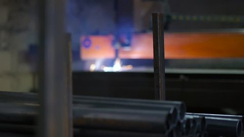 Plasma cutting of metal. Laser CNC machine. Cut sheet metal at workshop. Programmable highly accurate machine. Modern tool in heavy industry. Automatic work for ironwork. (30 fps)
