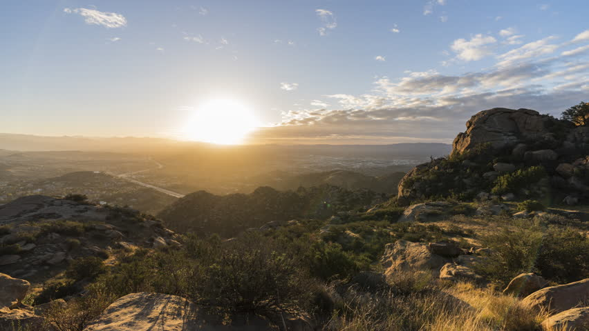 Sunrise time lapse view towards Porter Ranch in the San Fernando Valley area of Los Angeles California.  View from Rocky Peak Park in the Santa Susana Mountains. | Shutterstock HD Video #1007476624