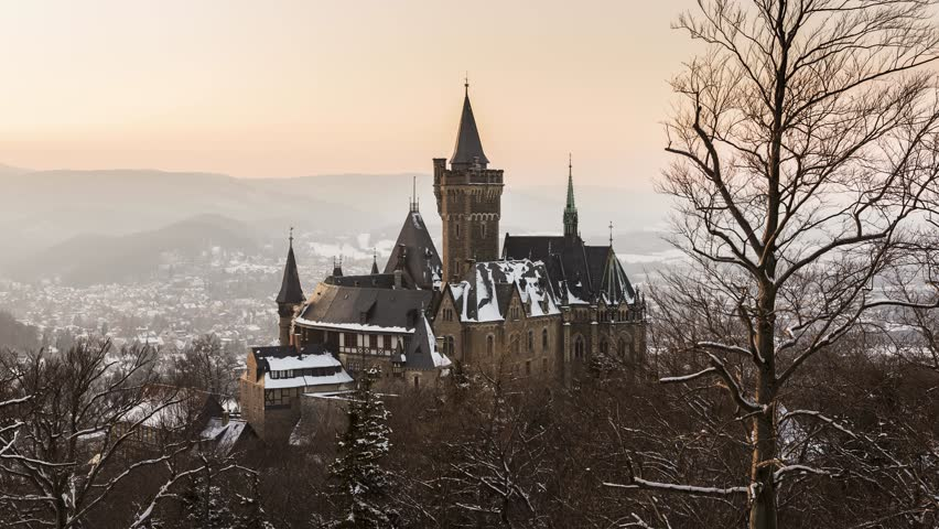 Wernigerode, Germany - February 6, 2018: Castle Wernigerode in winter with snow during dawn and view on the city of Wernigerode in Saksen-Anhalt.   Shutterstock HD Video #1007496790