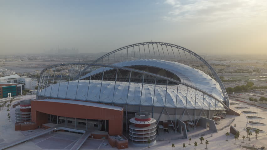 Aerial view of Aspire Zone from top at morning during sunrise timelapse in Doha. Foggy weather with rays of sun light