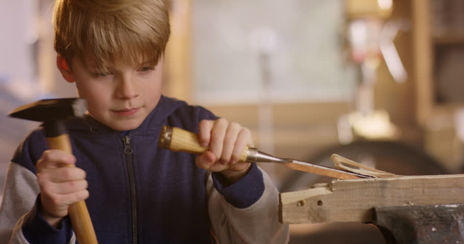 Young schoolboy is training his wood carving skills | Shutterstock HD Video #1007537938