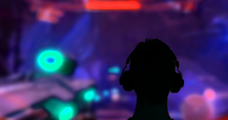 Gamer Silhouette Playing Videogame on Big Screen | Shutterstock HD Video #1007540461