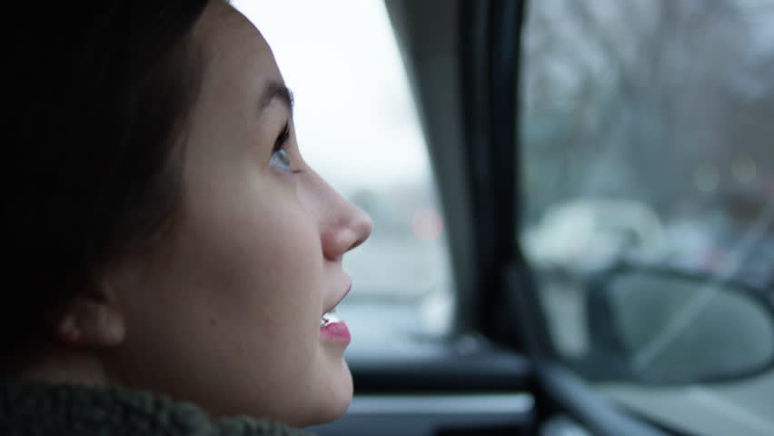 Happy Young Woman Looks With Wonder And Awe At All The Beautiful Sights Of The City From Passenger Side Car Window - Shot On Red Scarlet-W Dragon In 4K/ Slow Motion