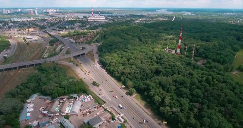 Aerial shot of a The Kiev, Ukraine. Road junction in the area of the metro vydubichi. Highway and overpass with cars and trucks, interchange, road junction in the big city. Top view.