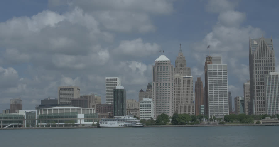 Panning wide shot of the Detroit River and waterfront of Detroit, Michigan.