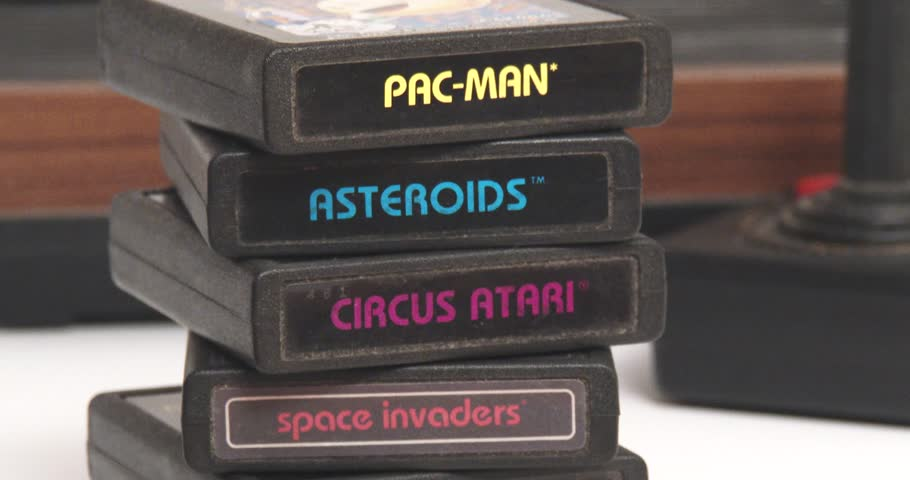 February 11, 2018, Bettendorf, Iowa, Atari 2600 Game Cartridges In Front Of Game Console - Pacman - Asteroids