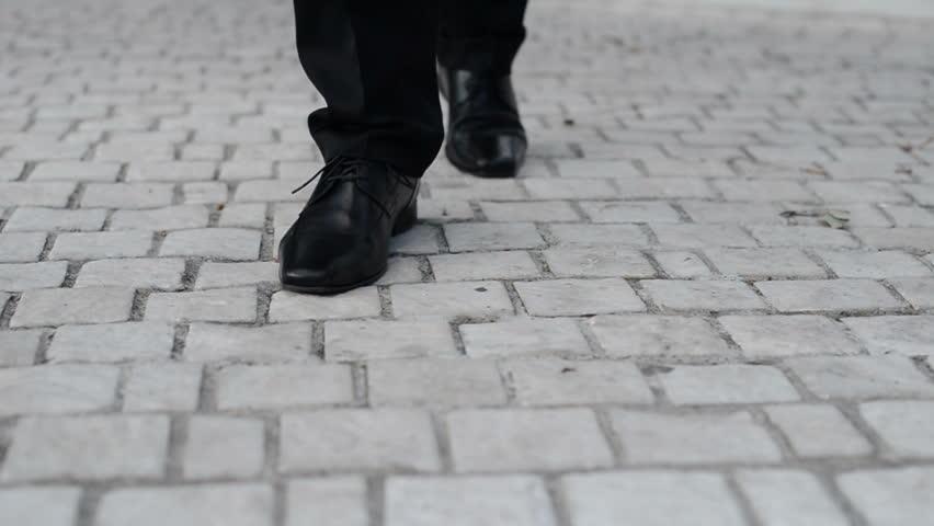 Down view on groom walking on pavement, preparing for wedding | Shutterstock HD Video #1007616100