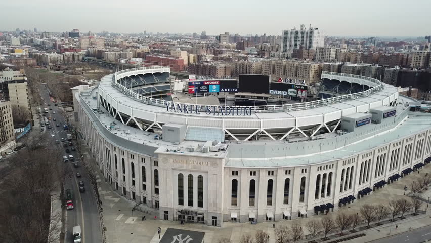 NEW YORK CITY - FEB 5, 2018: aerial of Yankee Stadium across front entrance sign 4K and 1080 HD in NYC. The new stadium is meant to evoke elements of the original one in the Bronx.
