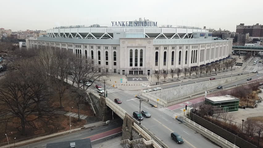 NEW YORK CITY - FEB 5, 2018: Yankee Stadium aerial front flyover NYC 4K 1080 HD in the Bronx, NYC. The famous stadium serves as the home ballpark for the New York Yankees of Major League Baseball.