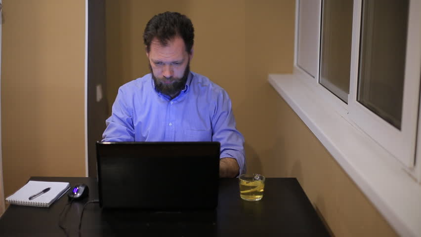 tired businessman in shirt and with beard running in office late at night laptop #1007633395