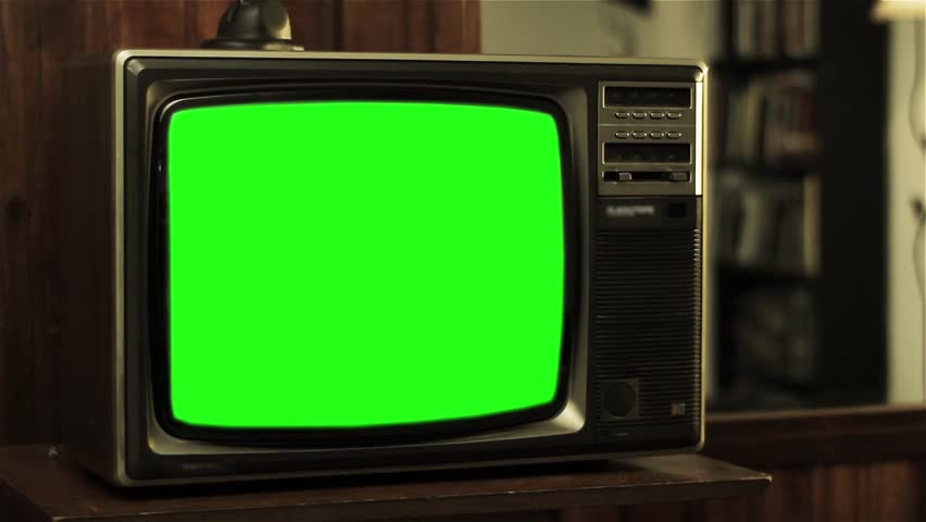 Man Talking on Old Phone near a Television with Green Screen. | Shutterstock HD Video #1007642218