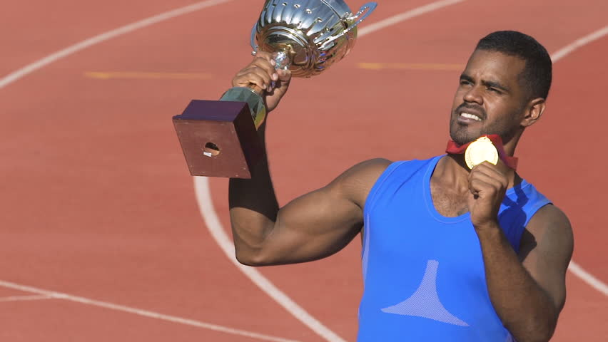 Male champion showing trophies to supporters, proud of victory and achievements | Shutterstock HD Video #1007644429