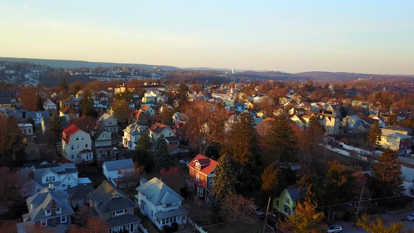 Aerial views of neighborhood houses in the suburbs of Yonkers, New York.   | Shutterstock HD Video #1007649121
