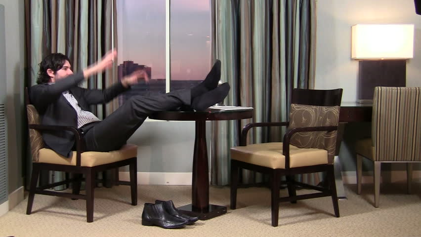 Successful businessman relaxes with his feet up - HD | Shutterstock HD Video #1007650