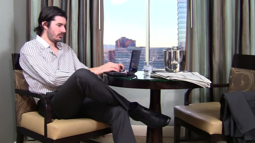 Relaxing businessman works on laptop computer in hotel room - HD | Shutterstock HD Video #1007662
