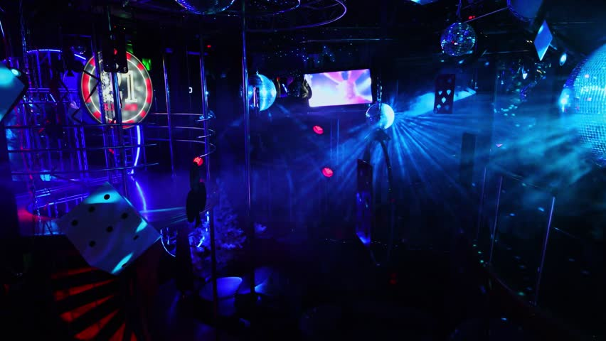 MOSCOW - DEC 09, 2016: Dancing area in White Bear striptease club with colorful illumination | Shutterstock HD Video #1007681530