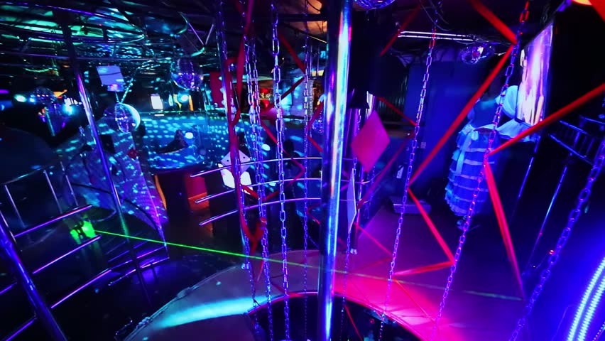 MOSCOW - DEC 09, 2016: Panorama of White Bear striptease bar with colorful illumination | Shutterstock HD Video #1007684173