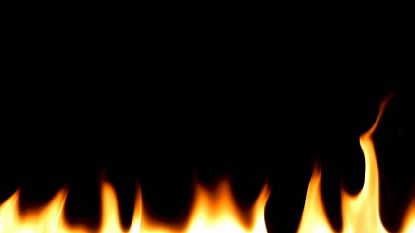 Realistic Fire Flames Igniting And Burning - Slow Motion. A line of real flames ignite on a black background.  #1007684491