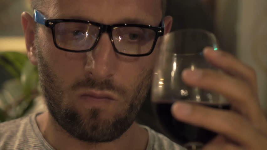 Sad, unhappy man drinking wine sitting in cafe at night  #1007686024