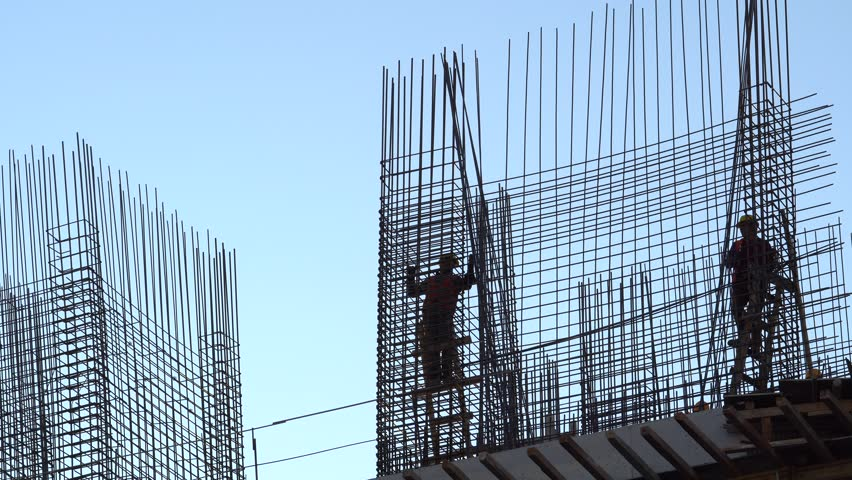 CONSTRUCTION WORKER SILHOUETTE  working with concrete iron near sunset   Shutterstock HD Video #1007686141