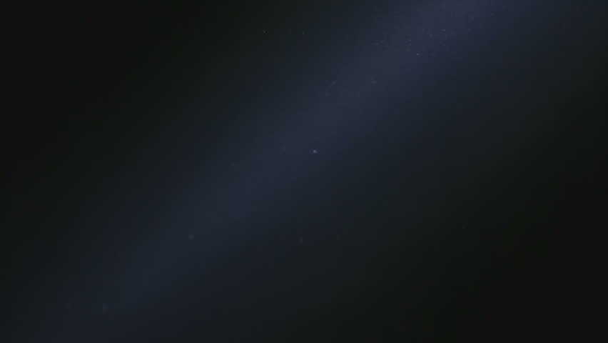 Natural Dust Organic Floating particles in stage light ray (spot) on black background. Dust in air atmosphere for your projects! Just drop it over your footage and use blending (screen) mode. | Shutterstock HD Video #1007688463