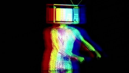 Slow motion of man with television covering face doing the floss dance wearing sparkly costume against black background