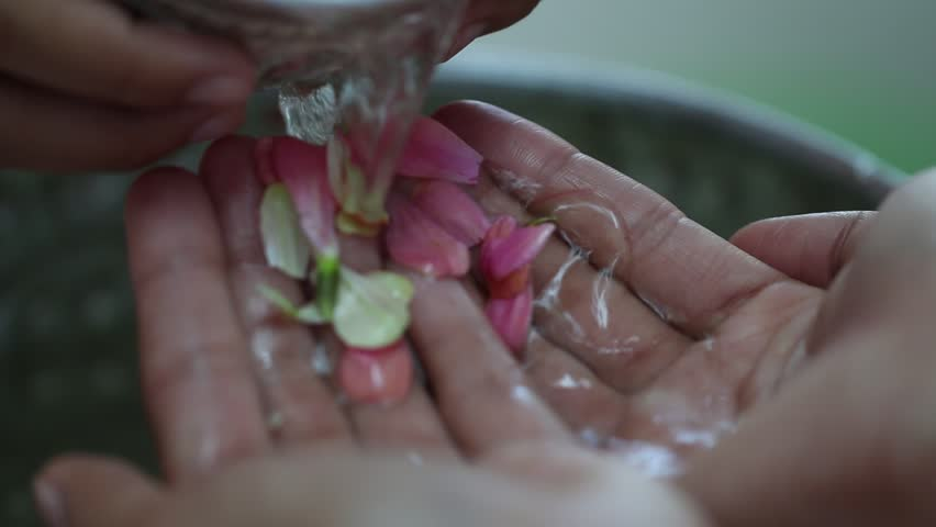 Songkran Thai festival concept : Thai people celebrate Songkran in new year water festival by giving garlands to elder seniors and asked for blessings to good life, Blur of Colorful Flowers background