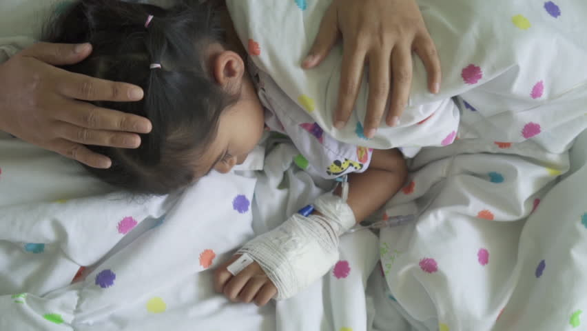 Sick asian child girl with hand bandaged hugging her mother with love in the hospital in slow motion shot