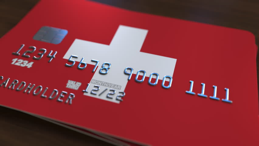 Plastic bank card featuring flag of Switzerland. National banking system related animation | Shutterstock HD Video #1007726494