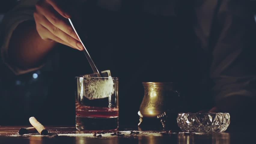 Barman make a cocktail