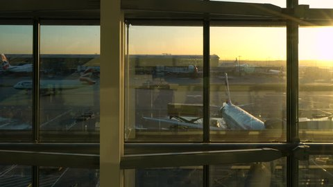 HEATHROW AIRPORT, TERMINAL FIVE, LONDON, ENGLAND – 12 FEBRUARY 2018: 4K video of British Airways airplanes on the runway apron at sunrise, Heathrow Airport, Terminal Five, London, England