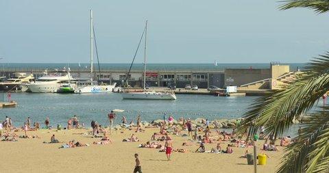 BARCELONA - CIRCA 2012: Beach and Boardwalk in Barceloneta, Barcelona, fun holidays, beach volleyball