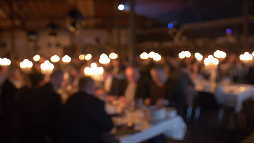 Diners celebrating at table in party unfocused  | Shutterstock HD Video #1007785897